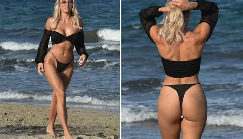 Towie's Amber Turner shows off rock-hard abs in a black